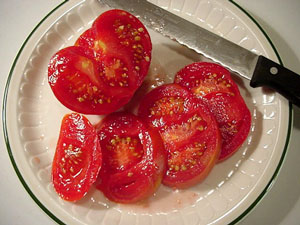 big-boy tomatoes in container